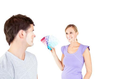 Young couple choosing color for a room