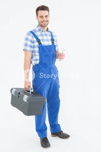 Male repairman carrying toolbox