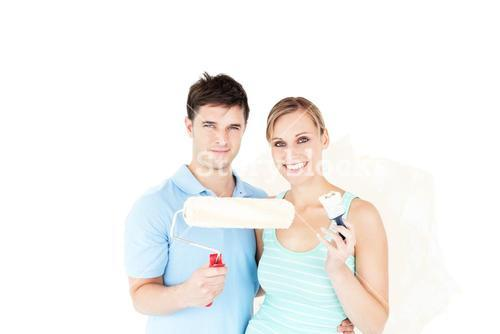 Charming couple painting a room