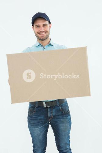 Courier man carrying cardboard box