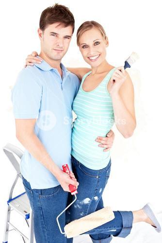 Loving couple painting a room