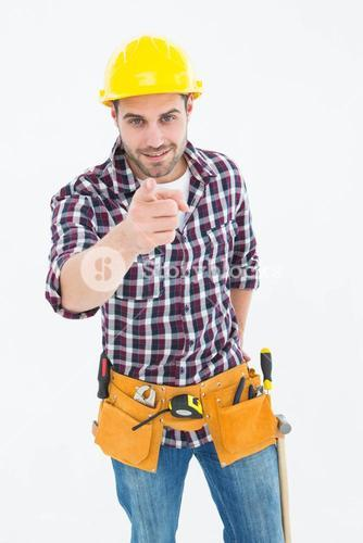 Confident male repairman pointing at you