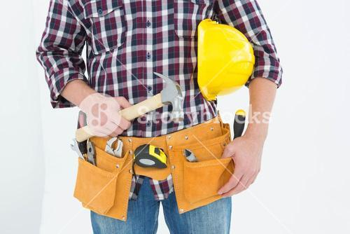 Repairman with hard hat and hammer