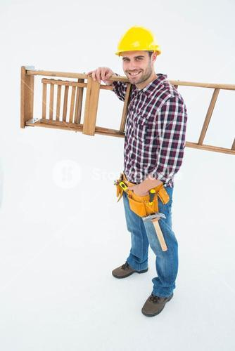 Confident handyman carrying ladder