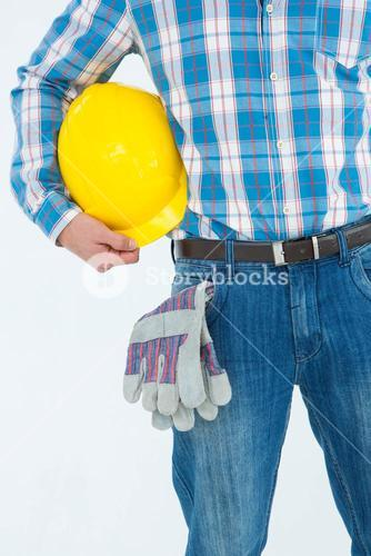 Manual worker with hard hat and gloves