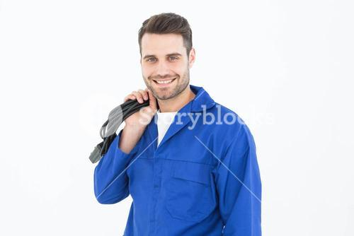 Smiling repairman holding cable