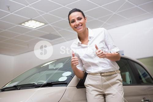 Smiling businesswoman giving thumbs up