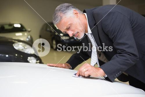 Focused cleaning a stain with his tie