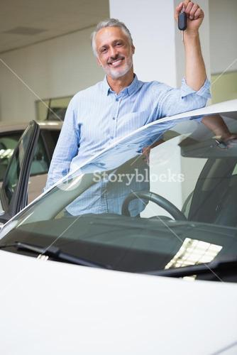 Smiling man holding car key