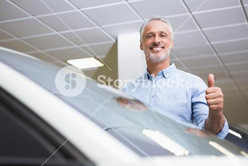 Smiling customer giving thumbs up