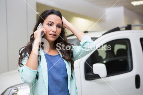 Upset woman calling someone with her mobile phone