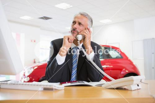 Upset businessman making a phone call