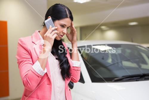 Sad woman calling someone with her mobile phone