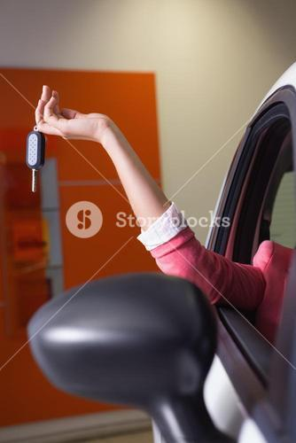 Womans hand holding car key