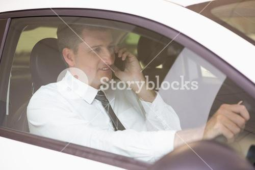 Smiling man on the phone in his car