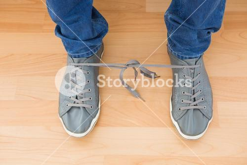 Mans shoes with tangled laces