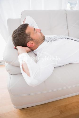 A businessman lying on the sofa