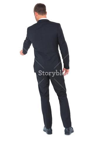 Businessman standing and looking down