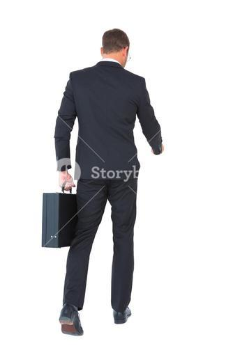 Businessman walking with his briefcase