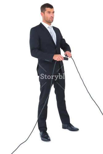 Businessman connecting a plug
