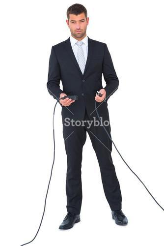 Businessman connecting cables together