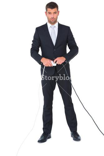 Serious businessman connecting a plug
