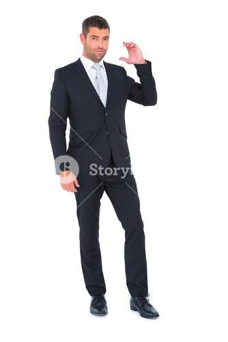 Businessman smiling with hand up