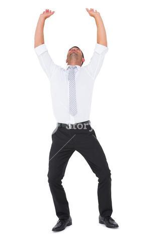 Businessman cheering with arms up
