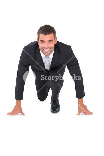 Smiling businessman crouching