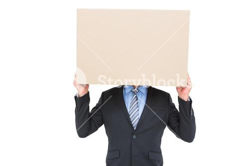 Businessman hiding head with a box