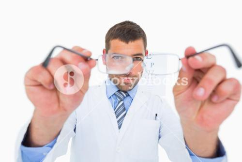 Smiling optician presenting eyeglasses