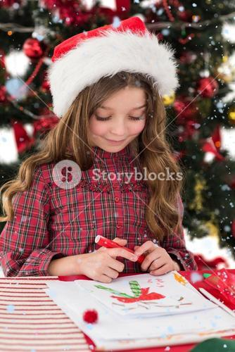 Composite image of festive little girl drawing pictures