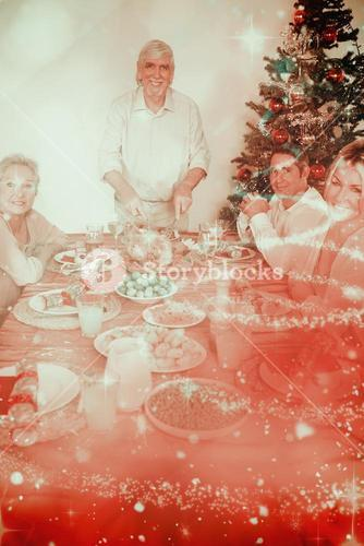 Composite image of happy grandfather carving the christmas turkey
