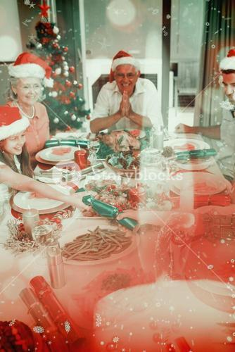 Composite image of cheerful family at dining table for christmas dinner