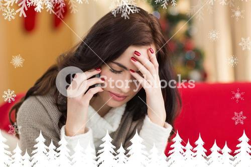 Composite image of concentrated brunette on the phone on christmas day