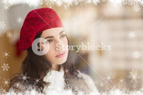 Composite image of portrait of a pretty brunette in day dreaming