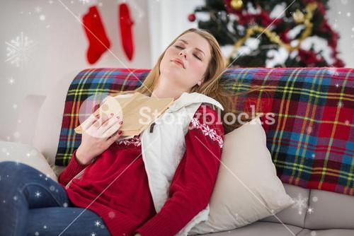 Composite image of young woman falling asleep while reading