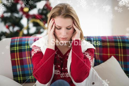 Composite image of pretty blonde woman having a headache on the sofa