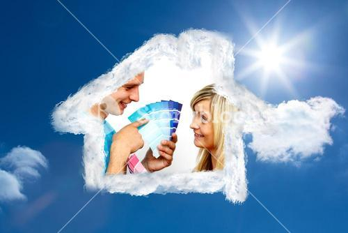 Composite image of cute couple chosing colours for painting house