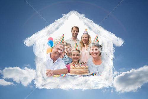 Composite image of cheeful family smiling at camera at birthday party