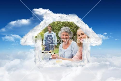 Composite image of happy extended family waiting for barbecue being cooked by father