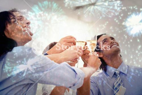 Composite image of cheerful business team toasting with champagne