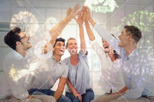Composite image of group therapy in session sitting in a circle high fiving