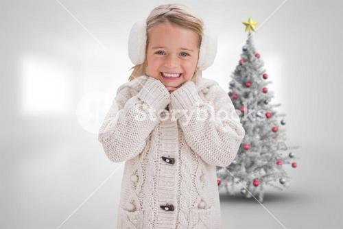Composite image of cute girl in ear muffs