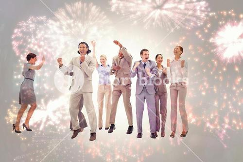 Composite image of very happy business people jumping and clenching their fists