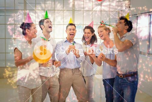 Composite image of casual business team celebrating with champagne and party poppers
