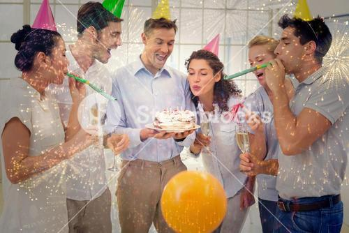 Composite image of casual businessmen team celebrating a birthday