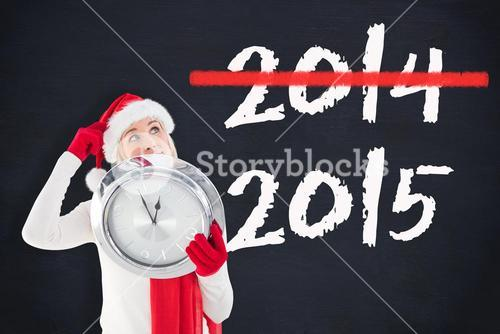 Composite image of festive blonde holding a clock