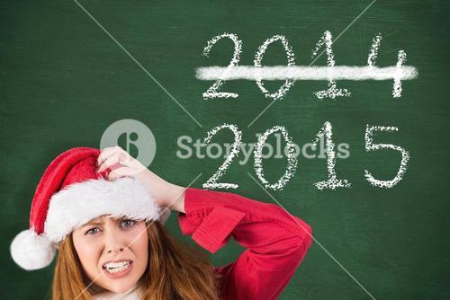Composite image of festive stressed redhead holding gifts
