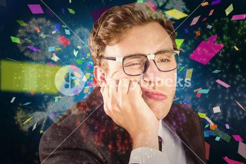 Composite image of young geeky businessman looking bored